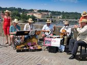 Prague, Czech Republic - June 15, 2006: Orchestra Of Street Musicians Play At Charles Bridge On June