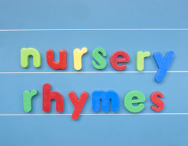 image of nursery rhyme  - Colorful magnetic letters spelling nursery rhymes on a blue board. ** Note: Soft Focus at 100%, best at smaller sizes - JPG