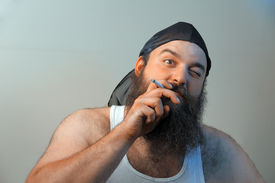 foto of wife-beater  - A smoking redneck questions his beliefs about life  - JPG