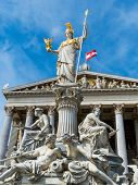 parliament in vienna, austria. with the statue of pallas athena of the greek goddess of wisdom.