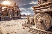 stock photo of chariot  - Stone chariot in courtyard of Vittala Temple at sunset overcast sky in Hampi Karnataka India - JPG
