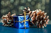 blue gift box with pinecone