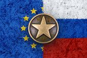 Bronze Star On European Union And Russian Flags In Background