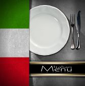 pic of italian flag  - Metallic background with textile italian flag empty white plate with silver cutlery fork and knife and black horizontal band - JPG