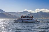 COPACABANA, BOLIVIA, MAY 7, 2014: Touristic boat transports tourists from Copacabana to Isla del sol on Titicaca lake