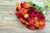 A Bouquet Of Roses On A Wooden Background Close Up