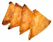 picture of samosa  - Spicy lamb and vegetable samosas isolated on a white background - JPG