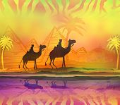 Camel Train Silhouetted Against Colorful Sky Crossing The Sahara Desert