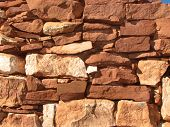 image of fieldstone-wall  - red sand stone wall stacked without mortar - JPG