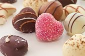 stock photo of truffle  - Selection of chocolate candy and truffles in heart shape - JPG