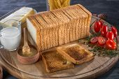 Toast sliced bread on wooden board
