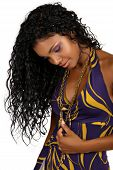 stock photo of black curly hair  - Beautiful African woman with long curly hair in purple halter neck dress and purple make - JPG