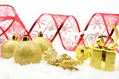 Golden Christmas Gifts,baubles Red Ribbon On Snow