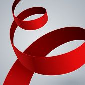 Red fabric curved ribbon on grey background
