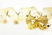 Golden Christmas Gifts,baubles With Golden Ribbon On Snow