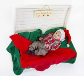 Cute Baby Boy With A Santa Claus Hat