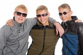 Three best friends in sunglasses. Two of the boys twin brothers.