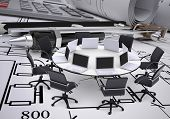 Round table, compasses, calculator and technical drawing