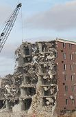 image of wrecking  - Wrecking ball demolition of abandoned building with rubble - JPG