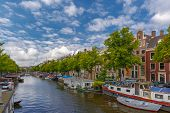 image of houseboats  - City view of Amsterdam canals and typical houseboats and boats Holland Netherlands - JPG