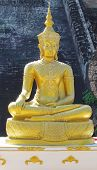 Golden Buddha seated.