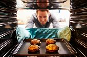 foto of picking tray  - Man Taking Cooked Tray Of Stuffed Mushrooms Out Of The Oven - JPG