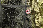 The Ban On Photographing The Object. A Sign At The Entrance Gate Metal. The Caves
