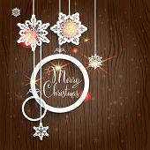 Christmas background on wood with snowflakes. Holiday decorations and place for text.