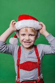 Beautiful little boy dressed like Santa Claus helper. Christmas concept