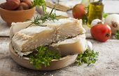 picture of ingredient  - salted codfish on the wooden table with ingredients - JPG