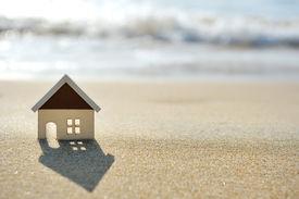 stock photo of sea life  - little house on the sand beach near sea - JPG