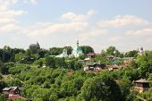pic of backwoods  - Green residential area with a church in Vladimir - JPG