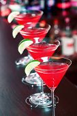 foto of cosmopolitan  - Four Cosmopolitan cocktails shot on a bar counter - JPG