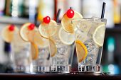 picture of collins  - Four Tom Collins cocktails shot on a bar counter - JPG
