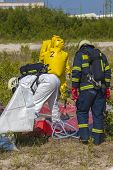 stock photo of hazardous  - Hazmat team members have been wearing protective suits to protect them from hazardous materials - JPG