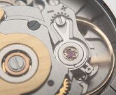 picture of wrist  - Extreme macro shot of the jewel mechanism of an automatic wrist watch  - JPG