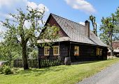stock photo of nice house  - Very old wooden house in nice summer weather - JPG
