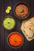 image of kidney beans  - Overhead shot of rustic bowls of homemade vegetable spreads  - JPG