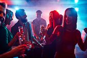 pic of club party  - Happy friends toasting at night party - JPG
