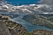 Hdr Image Of Preikestolen Cliff In Norway With A Storm Coming