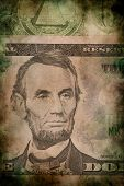stock photo of abraham  - Macro of Abraham Lincoln on five USA one dollar banknote grunge vintage style - JPG