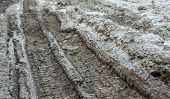 pic of dirt road  - Wheel tracks on the muddy dirt road after the rain - JPG