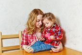 picture of feeding  - Mother give drink her baby girl by feeding bottle - JPG