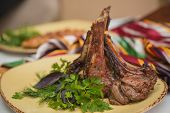 pic of veal  - Grilled organic veal fillet on yellow plate with salad - JPG