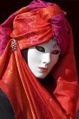 pic of carnivale  - woman dressed for carnivale with red scarf and jewels with mask - JPG