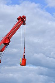 stock photo of boom-truck  - Boom Truck  lifted a tank in a sunny day - JPG