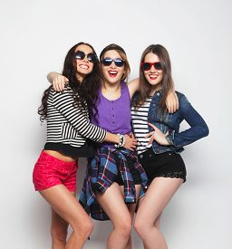 stock photo of three sisters  - Three stylish sexy hipster girls best friends - JPG