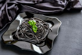 stock photo of cuttlefish  - Pasta With Wheat Germ And Black Cuttlefish Ink - JPG