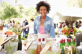 pic of stall  - Woman Selling Soft Drinks At Farmers Market Stall - JPG