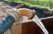 stock photo of groundwater  - pumping away fresh groundwater in a basin - JPG